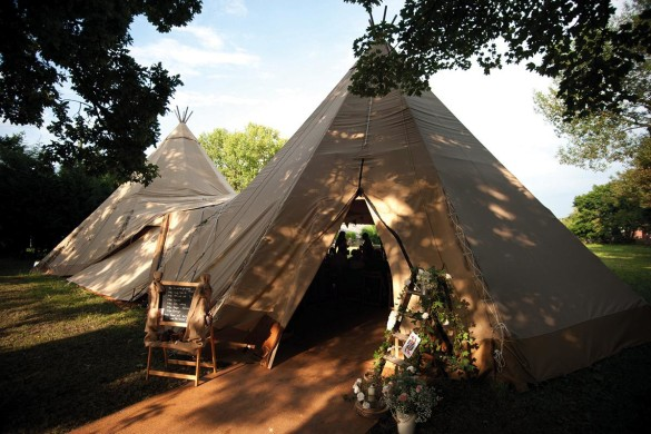 A tipi wedding with a fun Alice in Wonderland theme!