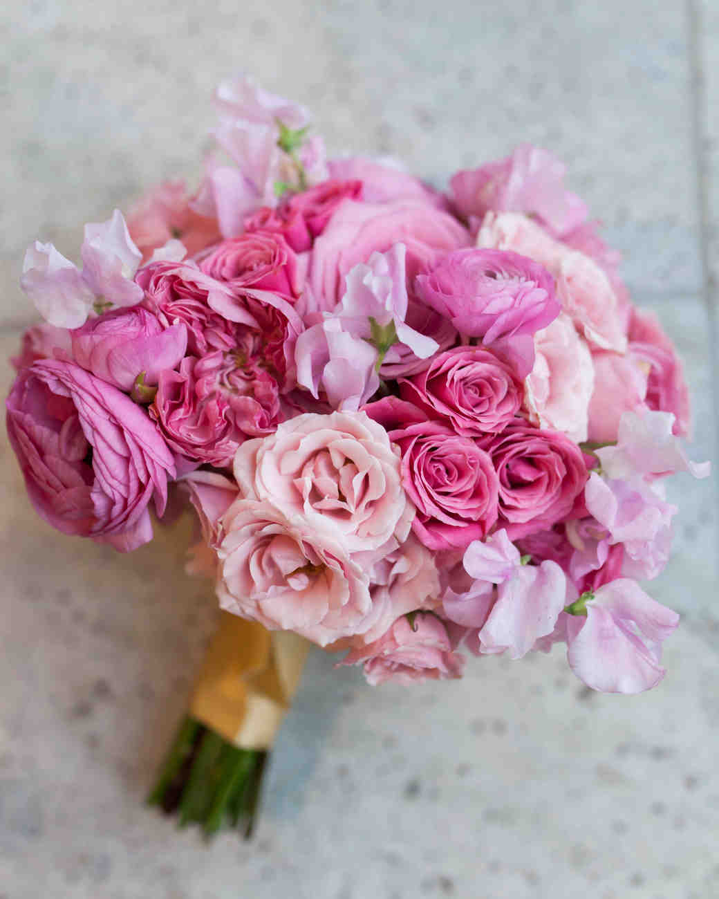 Rose, ranunculus and sweet pea bouquet. Image by cadenceandeli.com.