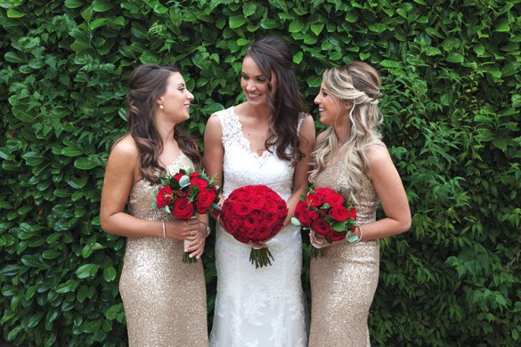 Red roses spell romance for this real wedding