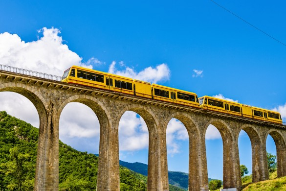 45618534 - the yellow train (train jaune) on sejourne bridge - france, pyrenees-orientales