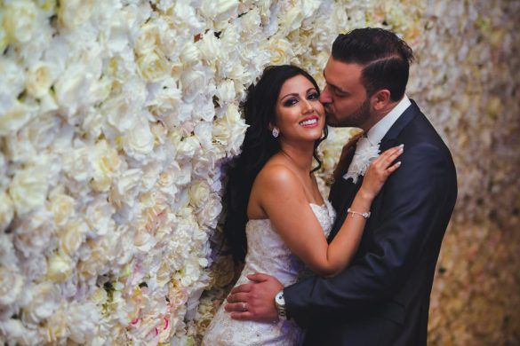 An elegant wedding with a stunning flower wall!